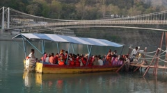 Rishikesh, people crossing the river in small ferry,Rishikesh,India Stock Footage