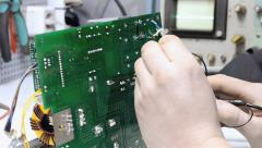Configuring the electronic device using an oscilloscope Stock Footage