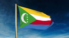 Comoros flag slider style. Waving in the wind with cloud background animation Stock Footage
