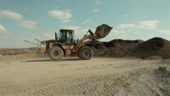 Bulldozer loading ground.Bulldozer charging shovel with soil.Landscape.Blue sky. Stock Footage