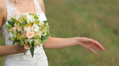 Bridal bouquet of flowers in hands of the bride - stock footage