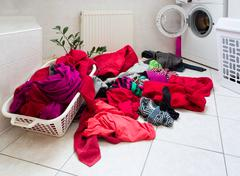 dirty clothes ready for the wash - stock photo