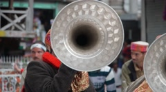 Men play horn at musical ceremony,Manikaran,Himachal Pradesh,India Stock Footage