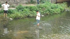 People fishing in the river Stock Footage