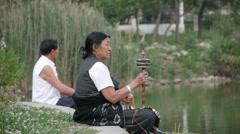 Tibetan Pelgrims with prayer wheel,Rewalsar,Himachal Pradesh,India Stock Footage