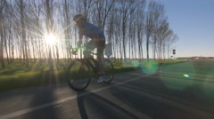 Healthy man racing bike tracking shot 4k Stock Footage