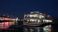 Passenger ferryboats of Istanbul: empty ferry departing at night Stock Footage