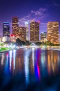 The downtown Los Angeles skyline reflecting at night, in Los Angeles, Califor Stock Photos