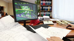 Architect with blueprints drafting the 3d model of building at the pc, man hands - stock footage