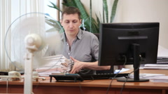 Engineer worker ending his work at office room, turning off all electric devices Stock Footage
