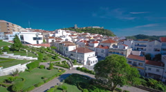Castle with houses with red roof near the city Sesimbra, Atlantic coast of Stock Footage