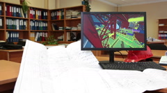Engineering company office with blueprints on the desk and 3d projecting on pc Stock Footage