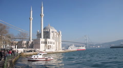 White mosque has got two minarets near Bosporus sea, on a bright day, Ortakoy Stock Footage