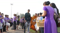 Monks collect alms on princess Sirindhorn birthday,Ubon Ratchathani,Thailand Stock Footage