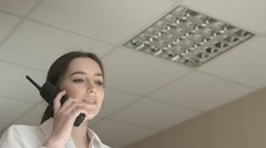 Young Woman Makin a Deal by the Phone Stock Footage