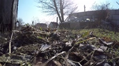 Pollution, dumping of garbage. The camera moves along the ground - stock footage