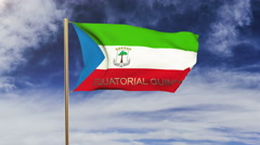 Equatorial Guinea flag with title waving in the wind. Looping sun rises style Stock Footage