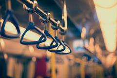 Handrails in a subway car Stock Photos