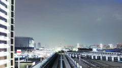POV Time Lapse of Urban Train Yurikamome at Night in Tokyo, Japan -close up 2- Stock Footage