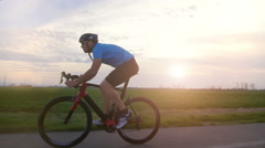 Cyclist rides bycicle tracking shot backlit 4k Stock Footage