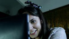 young woman having conversation via chat late in the night using the webcam - stock footage