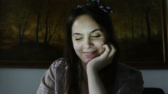 Very young woman chatting in the night using the webcam: perspective from webcam Stock Footage