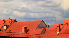 Stock Video Footage of Red roofs and clouds