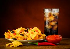 nachos, salsa dip and cola drink - stock photo