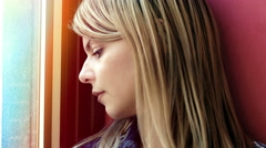 Sad and pensive woman near the window: depression, thoughtful Stock Footage