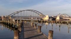 Sunset at Guldborg marina and bridge Stock Footage