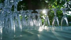 The sun through the leaves illuminates the glasses on the buffet's table Stock Footage