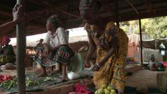 Africa: produce and saleswoman at local market Stock Footage