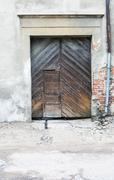 Old house wall with wooden dors Stock Photos