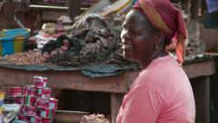 Africa: female merchant at local market - stock footage