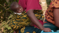 Africa: baby in sack on back woman Stock Footage