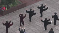 Chinese people practice Tai Chi in Nanjing Road Shanghai China Stock Footage