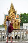 Tourists take photo in the Bang Pa-In Palace in Ayutthaya, Thailand Stock Photos