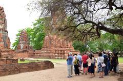 Tourists visit Wat Chaiwatthanaram in Ayutthaya, Thailand Stock Photos