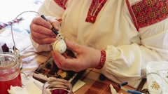 Man paints the Easter Egg Stock Footage