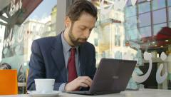 Businessman at work in a cafè: cafeteria, bar, restourant, table, sitting Stock Footage