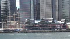 Pier 17 port harbour New York City traffic street skyscraper building modern day Stock Footage