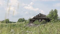 Ruined wooden house on the hill Stock Footage