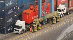 Trucks being loaded with cargo containers at the port of Valparaiso, Chile. Stock Footage