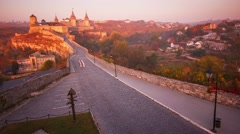 Timelapse of car traffic on the road to the castle in Kamianets-Podilskyi at Stock Footage