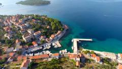 Aerial footage of village and harbour in Croatia Stock Footage