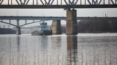 the ship sails under the bridge - stock footage