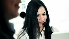 women at work in a call center: customer care center - stock footage