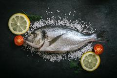 Gilthead fish and ingredients Stock Photos