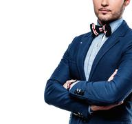 Stock Photo of Sharp dressed fashionist wearing jacket and bow tie