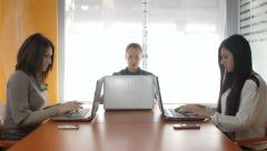 Team work: business women working in office with personal computers: laptop Stock Footage